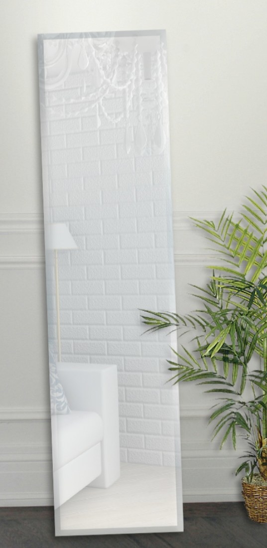 The mirror is a long rectangular shape with reflective beveled edges