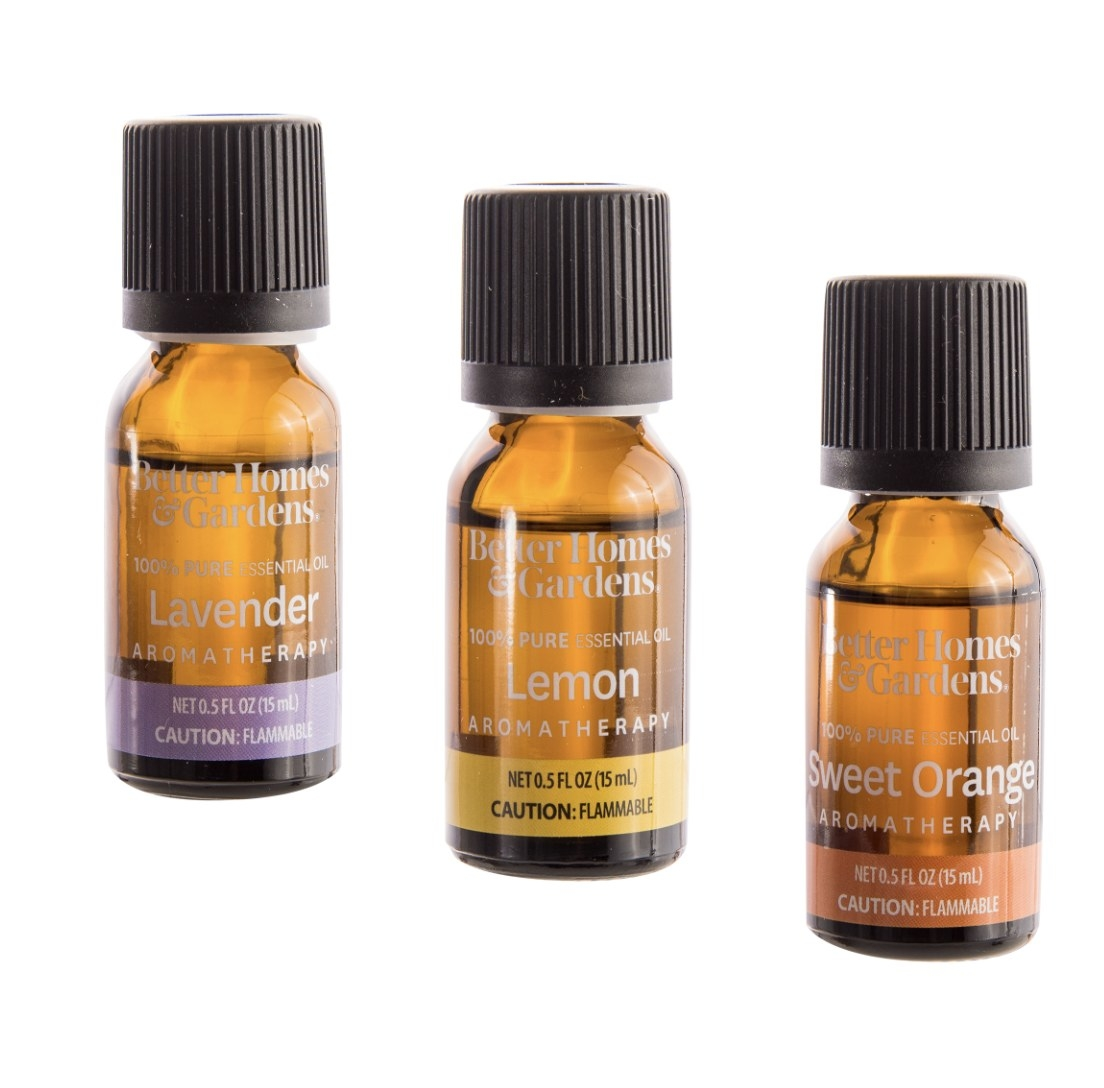 There are three bottles: one says Lavender with a purple stripe, another Lemon with a yellow stripe and the last Sweet Orange with an orange stripe
