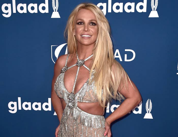Britney smiles big while attending an event in a crystal dress