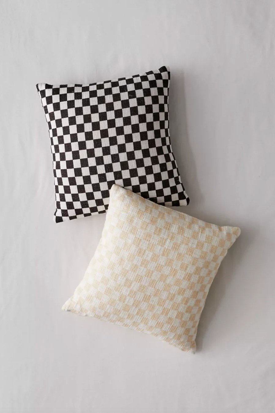 the checkerboard throw pillows in black and taupe