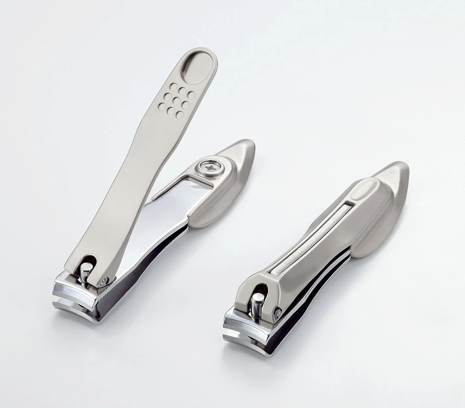 The nail clippers shown open and closed