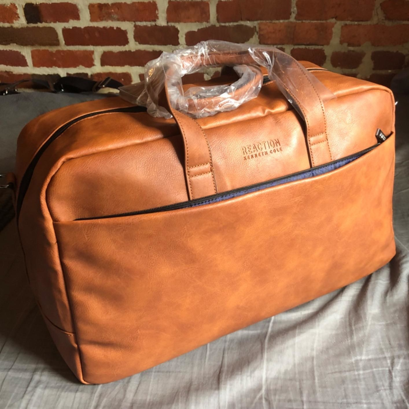 A cognac vegan leather bag with a pocket in the front