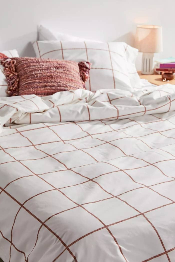 the distressed checked duvet in white and light brown