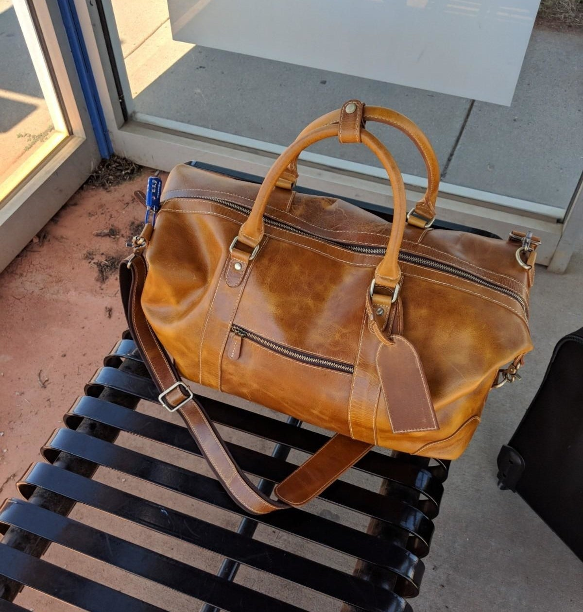 Reviewer photo of a brown leather duffel bag