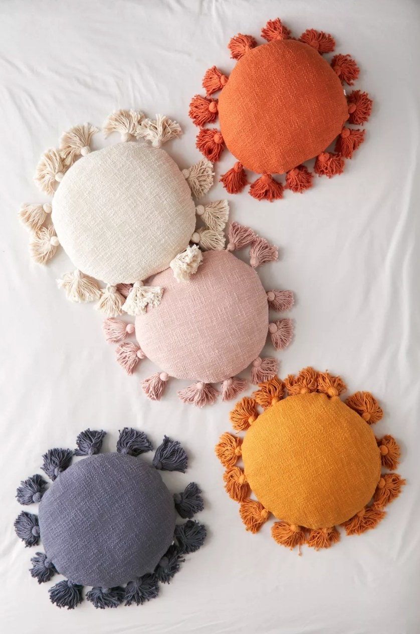 the round throw pillows in different colors