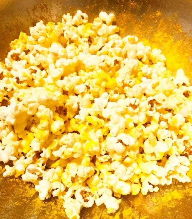 Popcorn seasoned with the cheese powder from mac 'n' cheese.