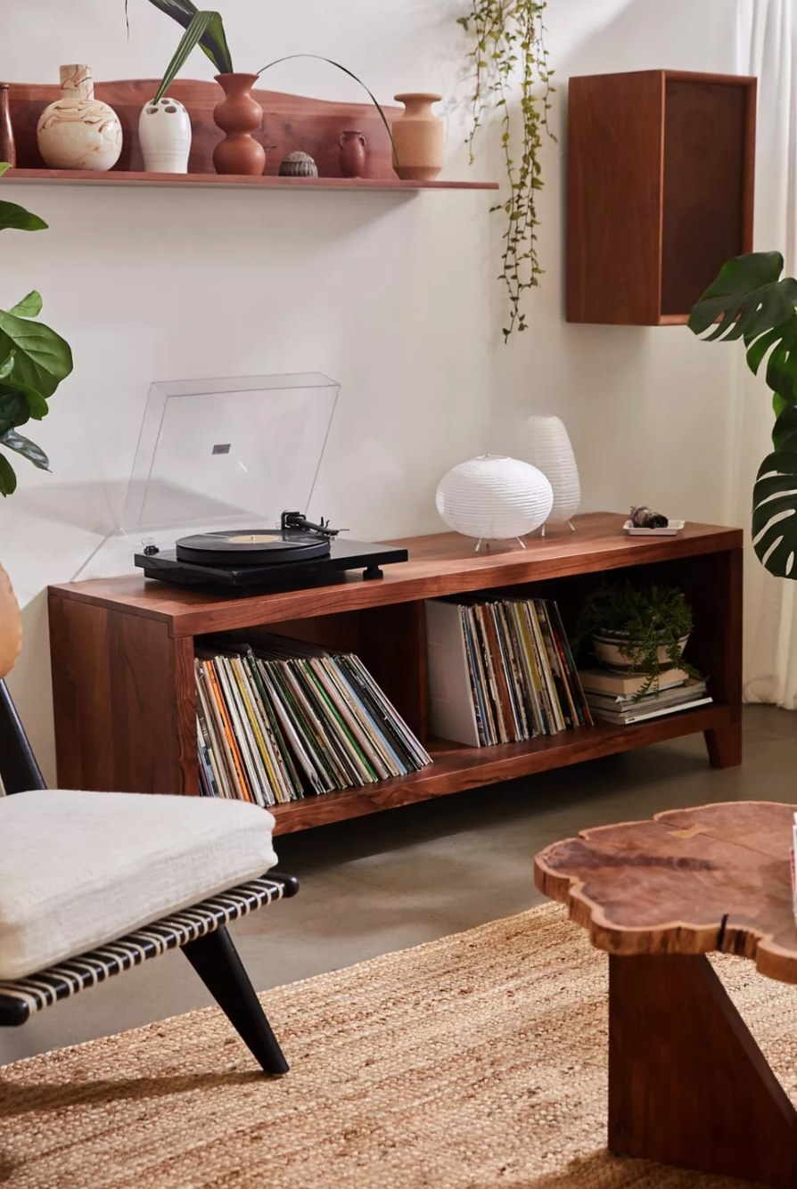 the cherry wood credenza holding records