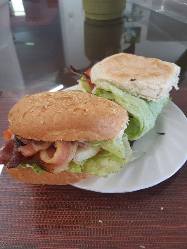 A sandwich with the ingredients folded in a piece of lettuce.
