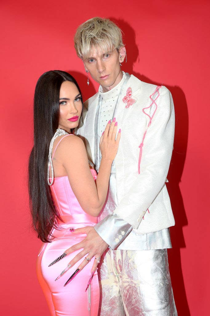 Megan and MGK embrace as they pose for a photo showing off their amazing nails