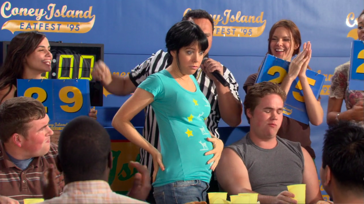 """Lily holding her stomach after an eating contest in """"How I Met Your Mother"""""""