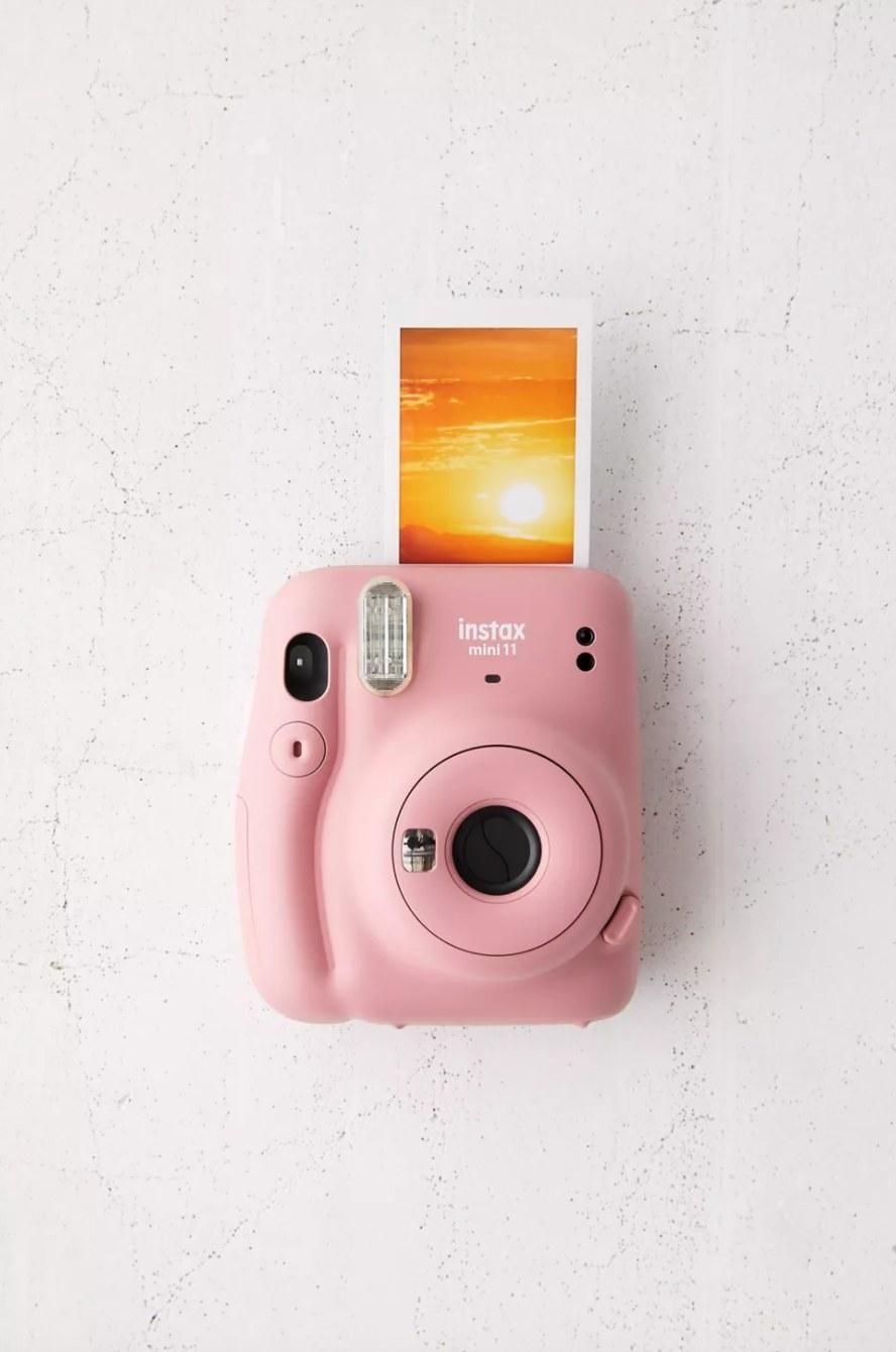 the small Fuijfilm camera in rose