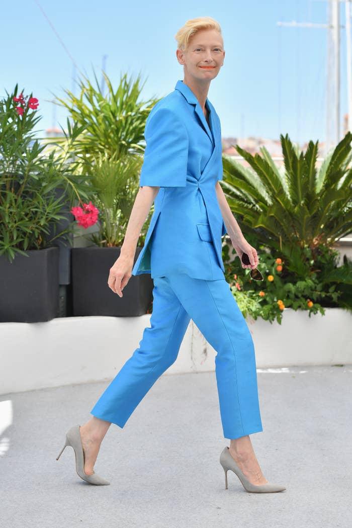 Tilda Swinton wears a pastel blue pantsuit at the Cannes Film Festival