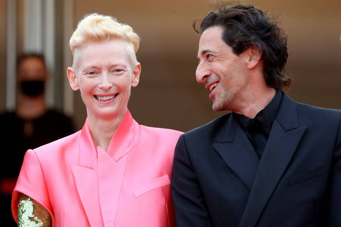 Tilda Swinton laughs with Adrien Brody at the Cannes Film Festival