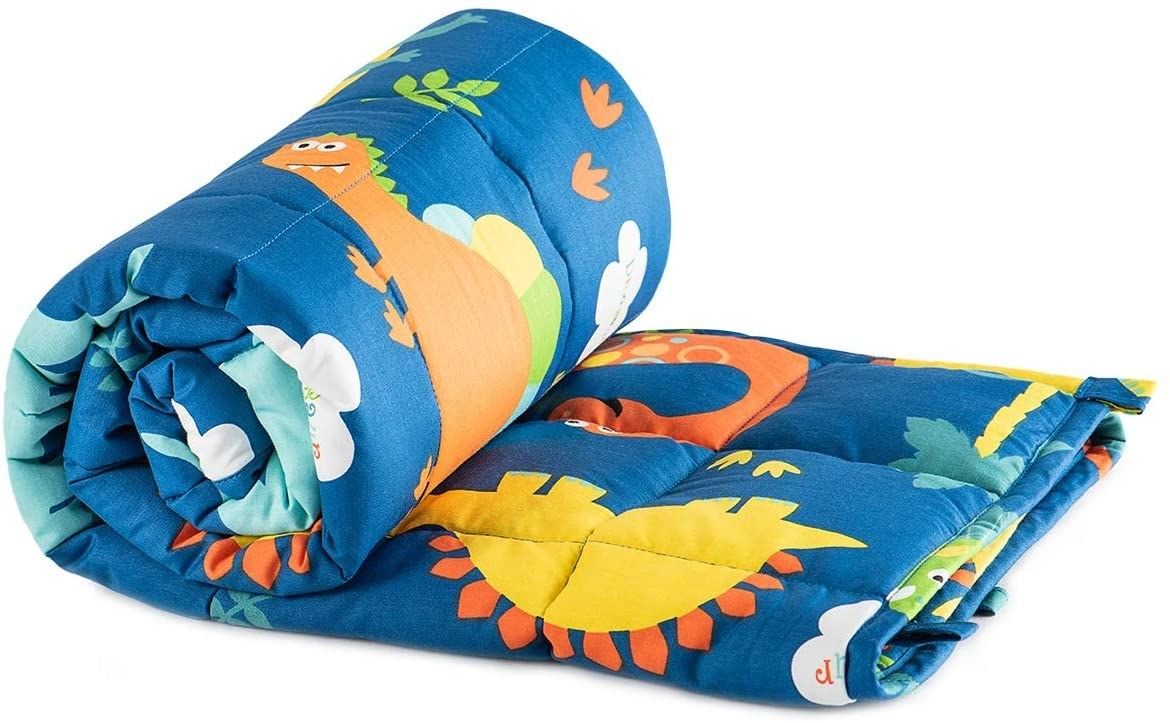 The blue weighted blanket in dinosaur print