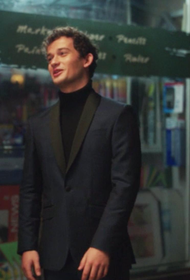 Obie wears a turtleneck under a tight fitted blazer