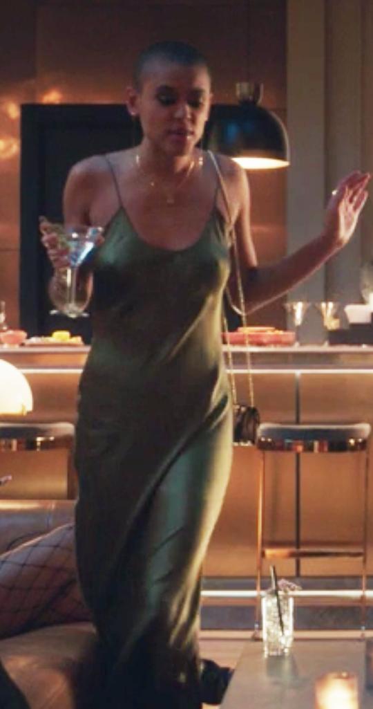 Julien wears a floor length satin slip dress