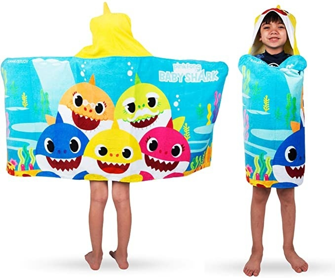 A child showing the front and back of the hooded baby shark towel wrap