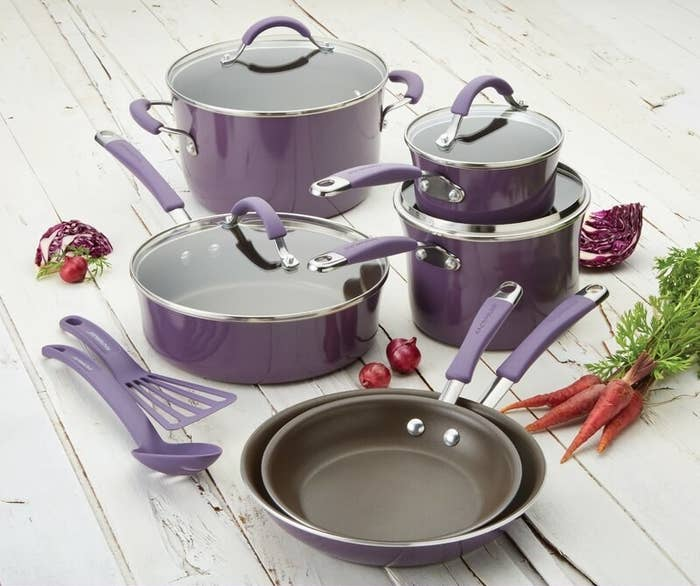 the purple cookware set on a counter