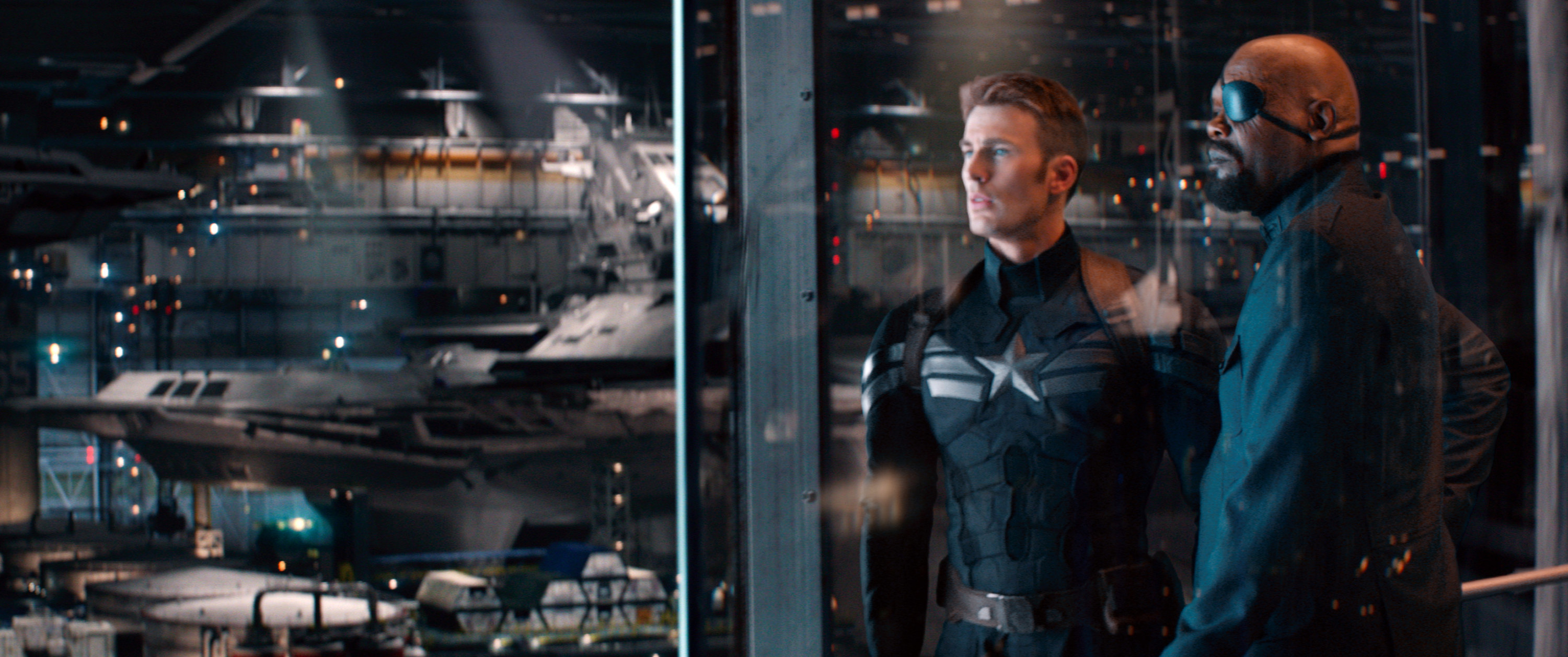 Captain America and Nick Fury look at SHIELD's collection of fighter jets
