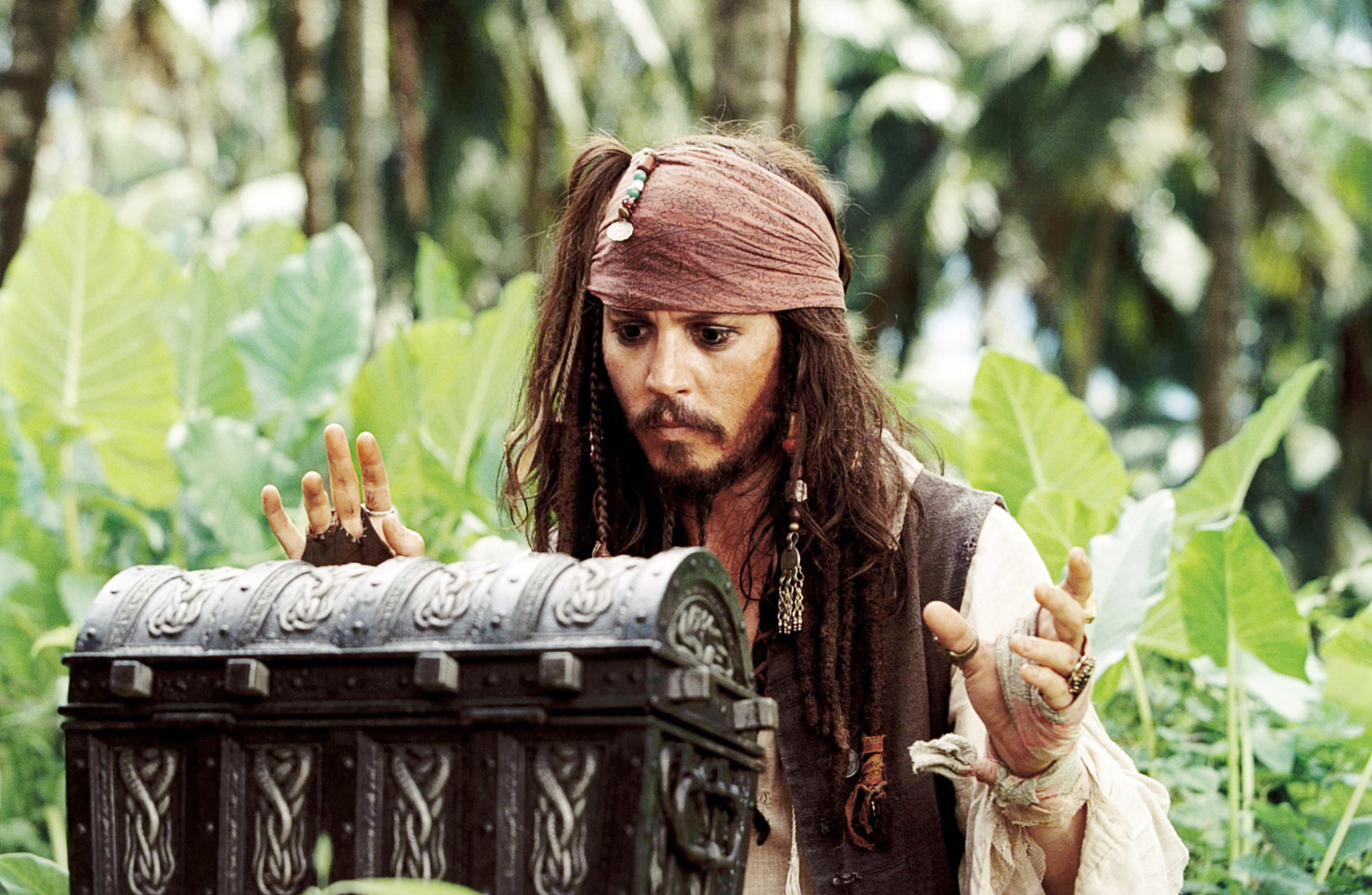 jack sparrow approaching a wooden chest