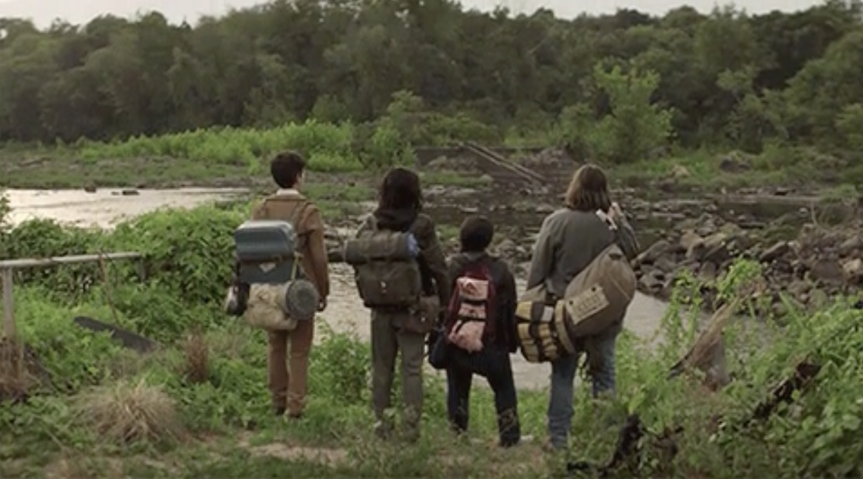 The cast staring out at the forest