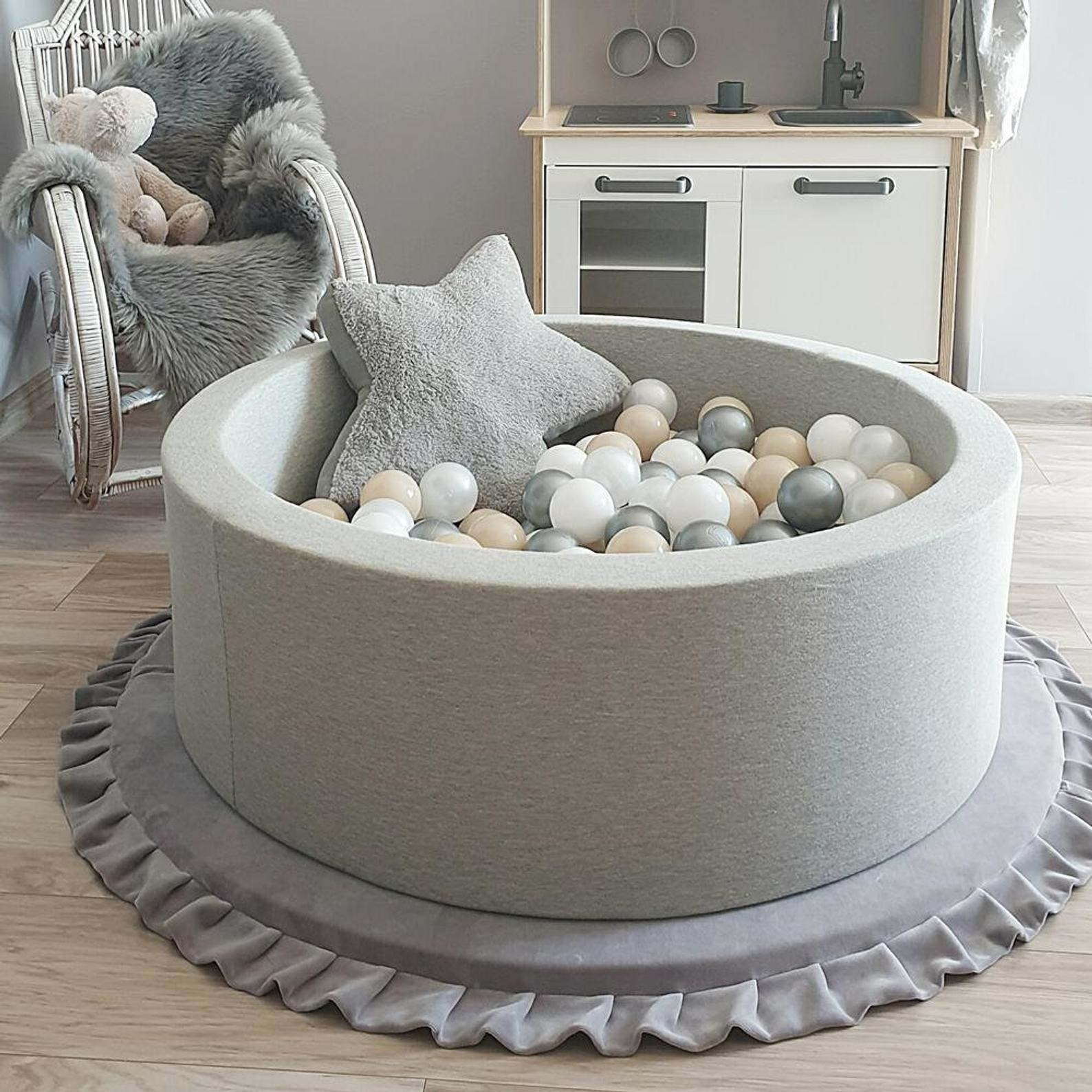 The grey foam ball pit filled with balls