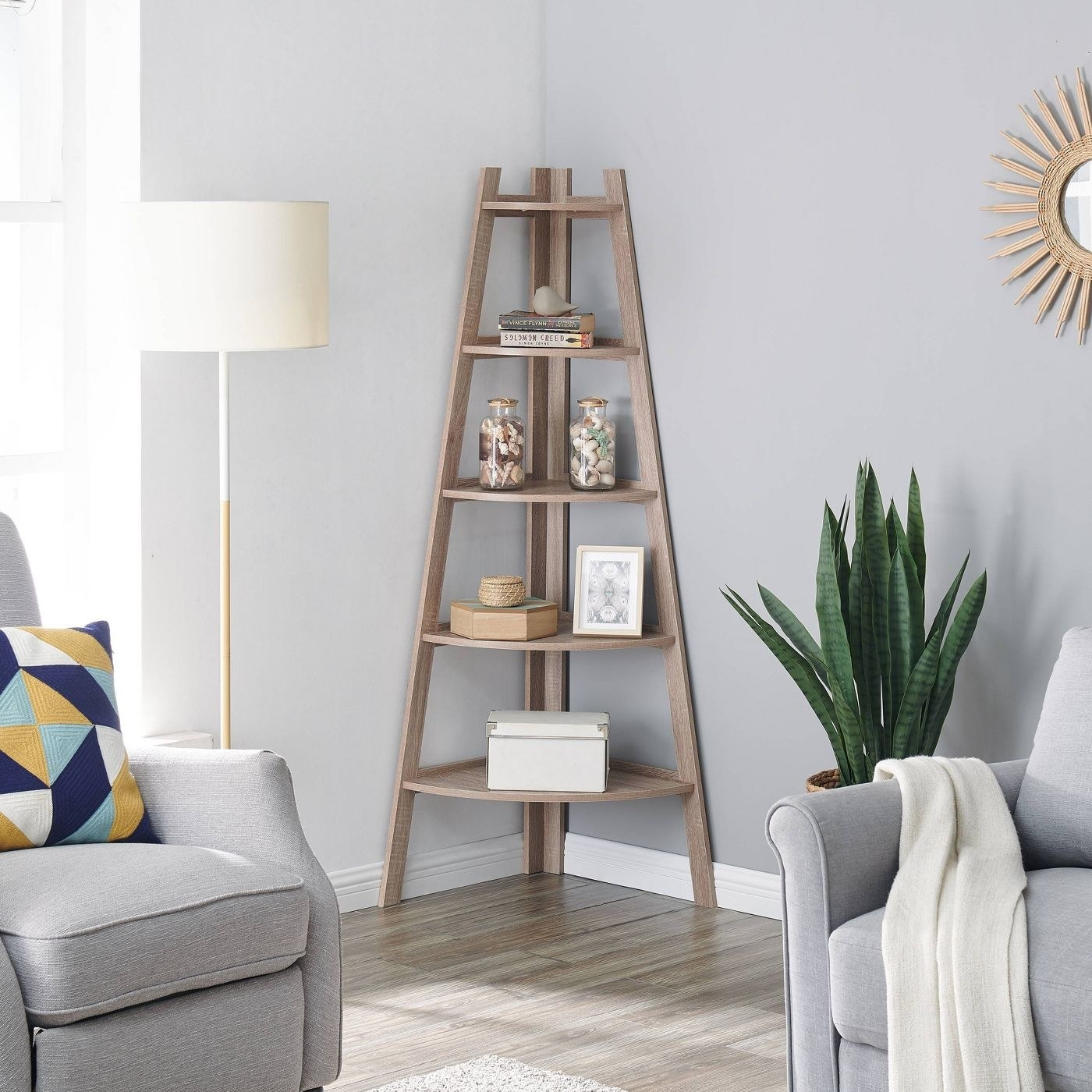 oak colored corner shelf with tripod frame and 5 rounded shelves