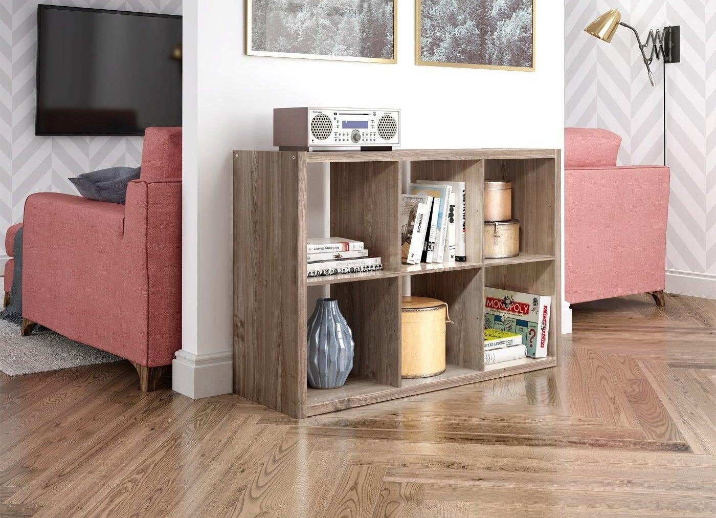 grey oak 6-cube organizer shelf against a wall with decor inside