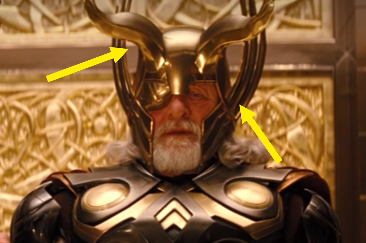 Odin wearing his ornate helmet that has long wings that go up the sides on the cheek and horns that curve coming out the front