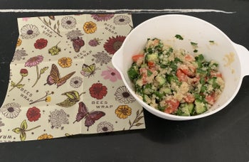 Author's bowl of leftovers, with the flat reusable wrap on the side