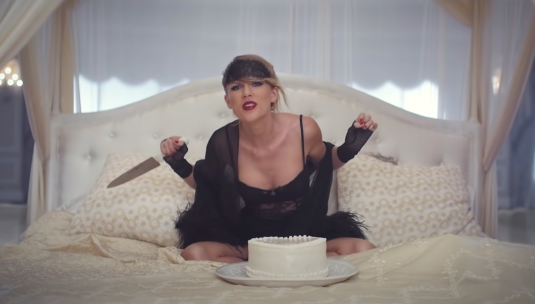 she stabs a heart-shaped cake in the music video