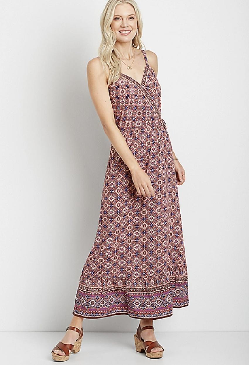model wearing pink printed dress