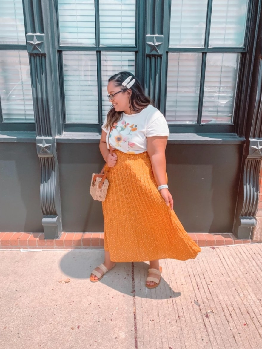 reviewer wearing the skirt in orange