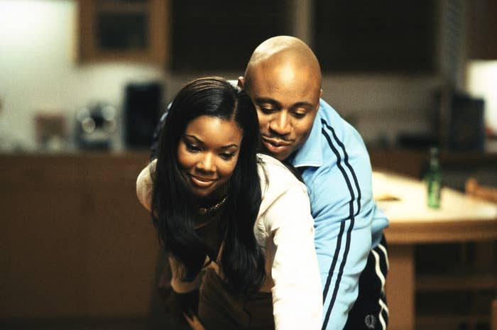 LL Cool J holding Gabrielle Union from behind in the film