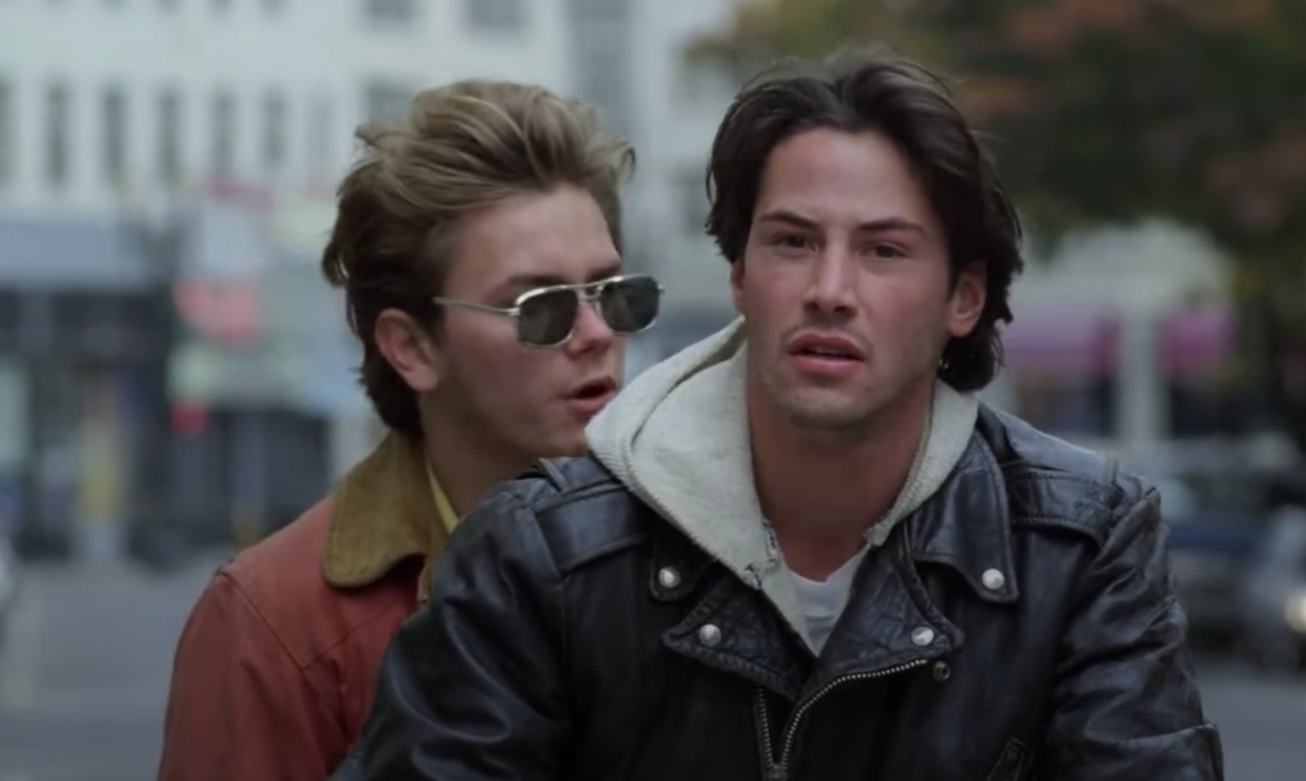 Cool, bohemian Reeve rides a motorcycle with an equally cool River Phoenix on the back in my own private idaho