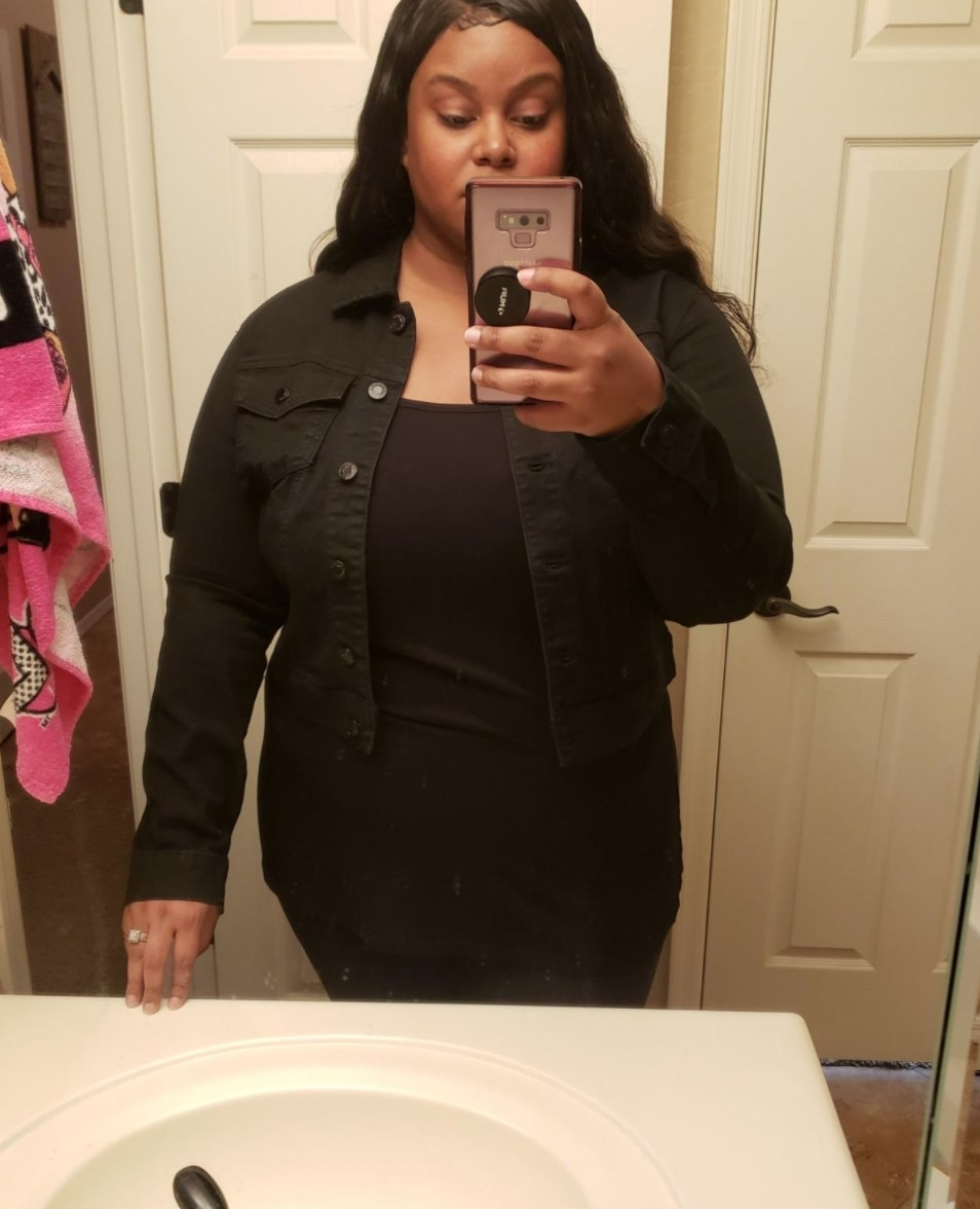 reviewer wearing the jacket in black
