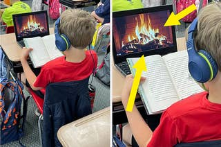 A kid reading a book in front of a video of a fireplace