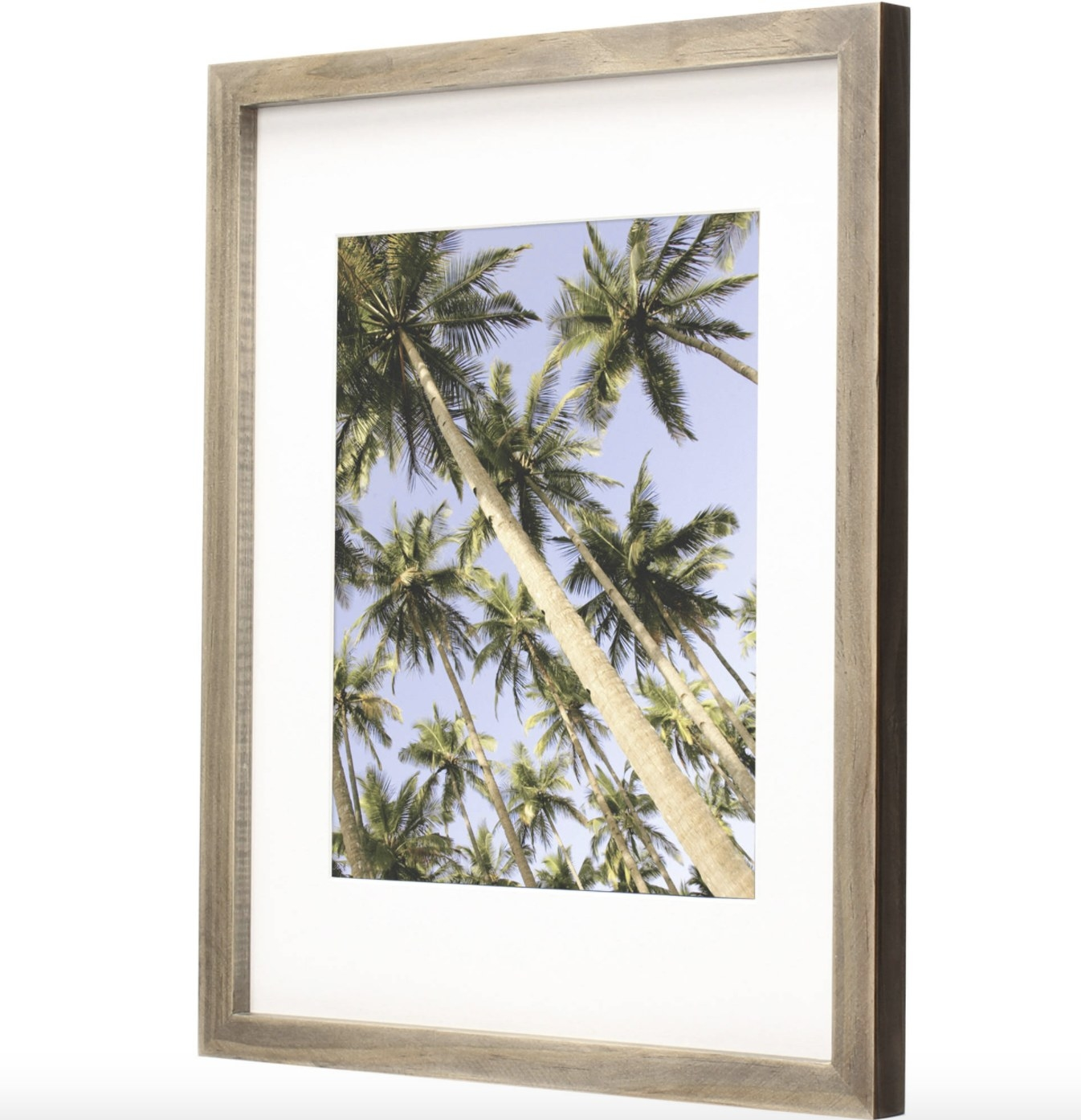 The rustic frame is grey with a photo of palm trees in a blue sky