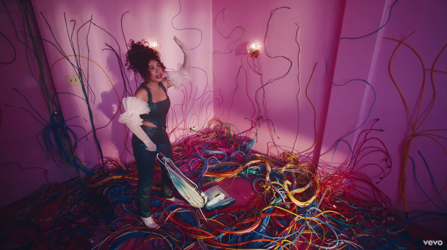 """Alessia vacuuming a room full of wires in """"Sweet Dream"""" music video"""