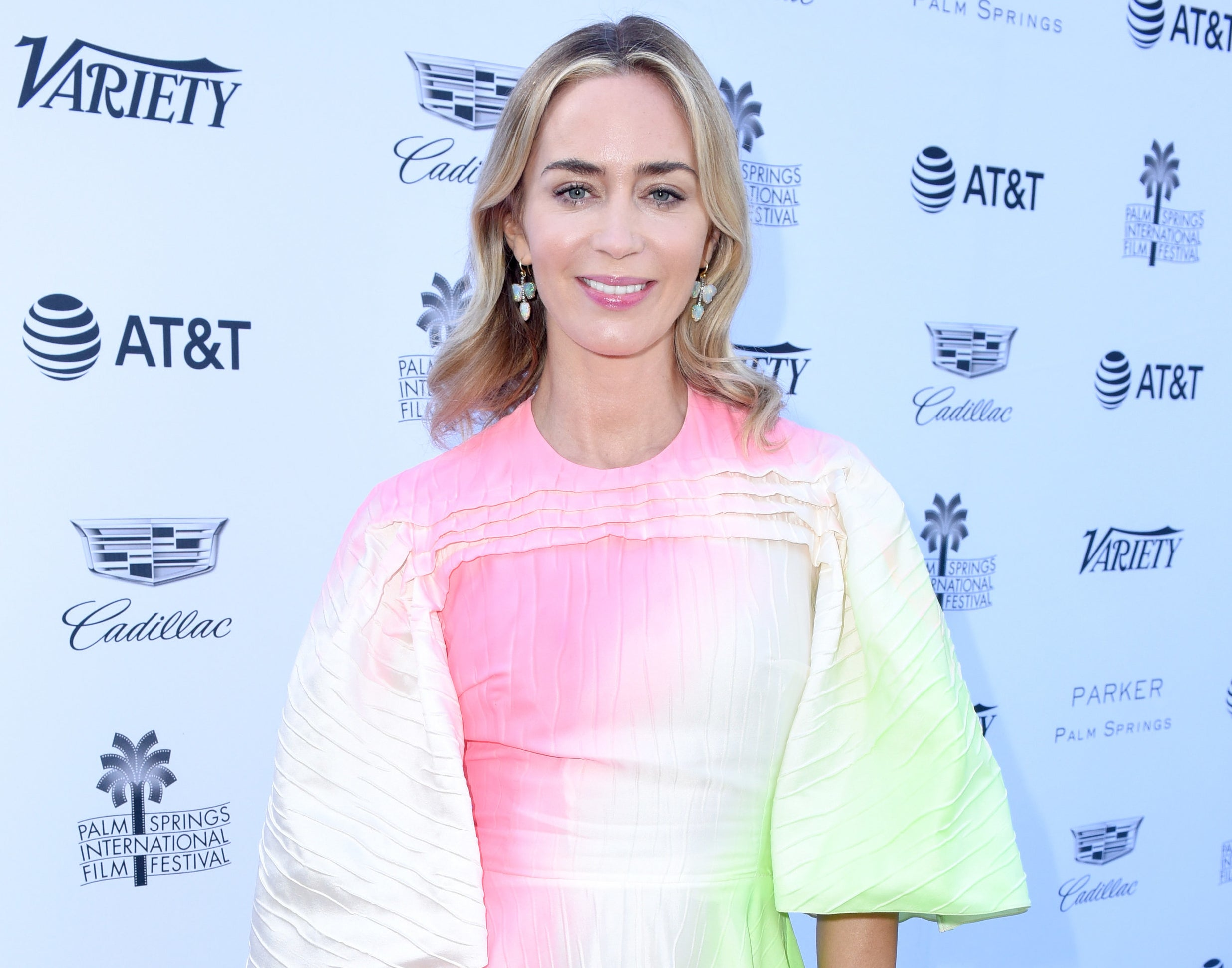 Emily attends an event in a white, pink, and green ombre dress with puffy sleeves