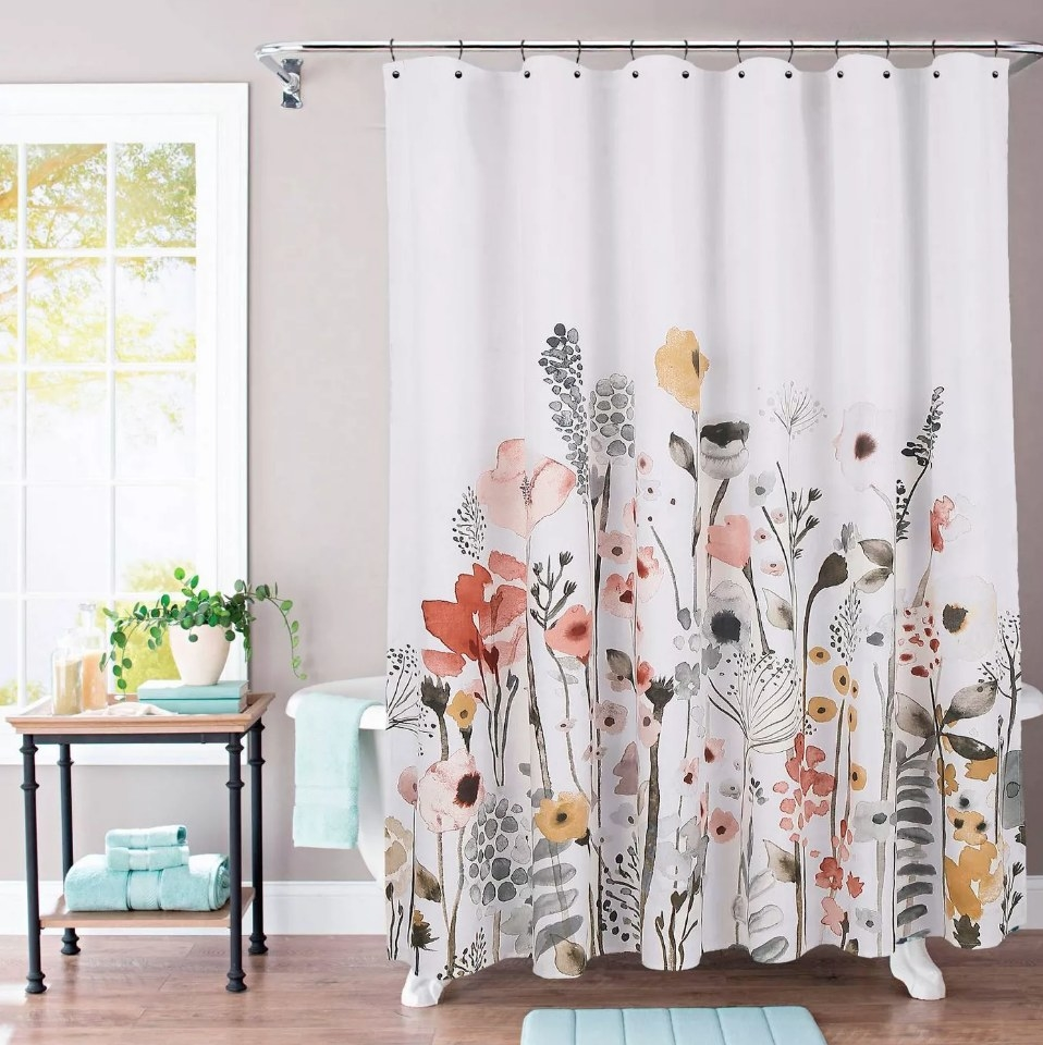 White shower curtain with yellow, pink and black floral design
