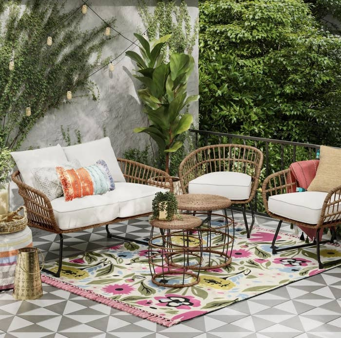 Patio chairs with other outdoor furniture on patio