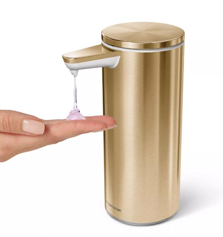 Model dispensing soap from gold touch less dispenser