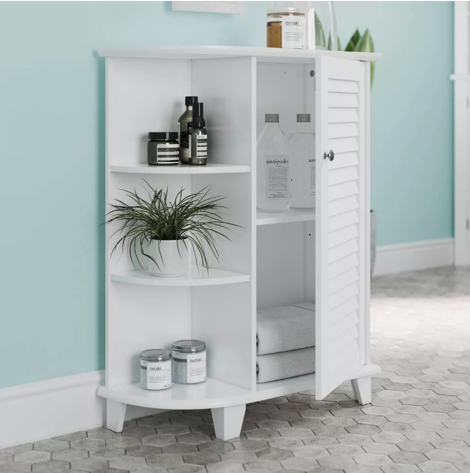 White floor cabinet wtih shuttered cabinet door ajar and three side shelves