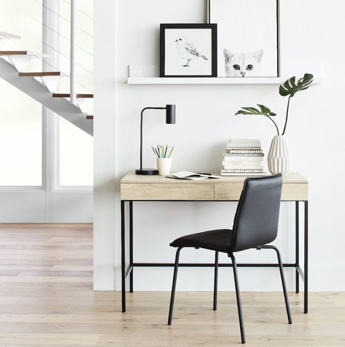 light wood writing desk with two drawers and metal legs