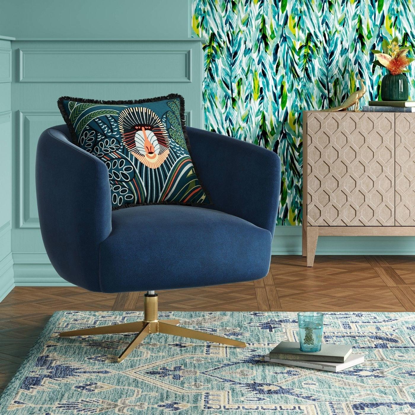 navy blue velvet swivel armchair with gold base