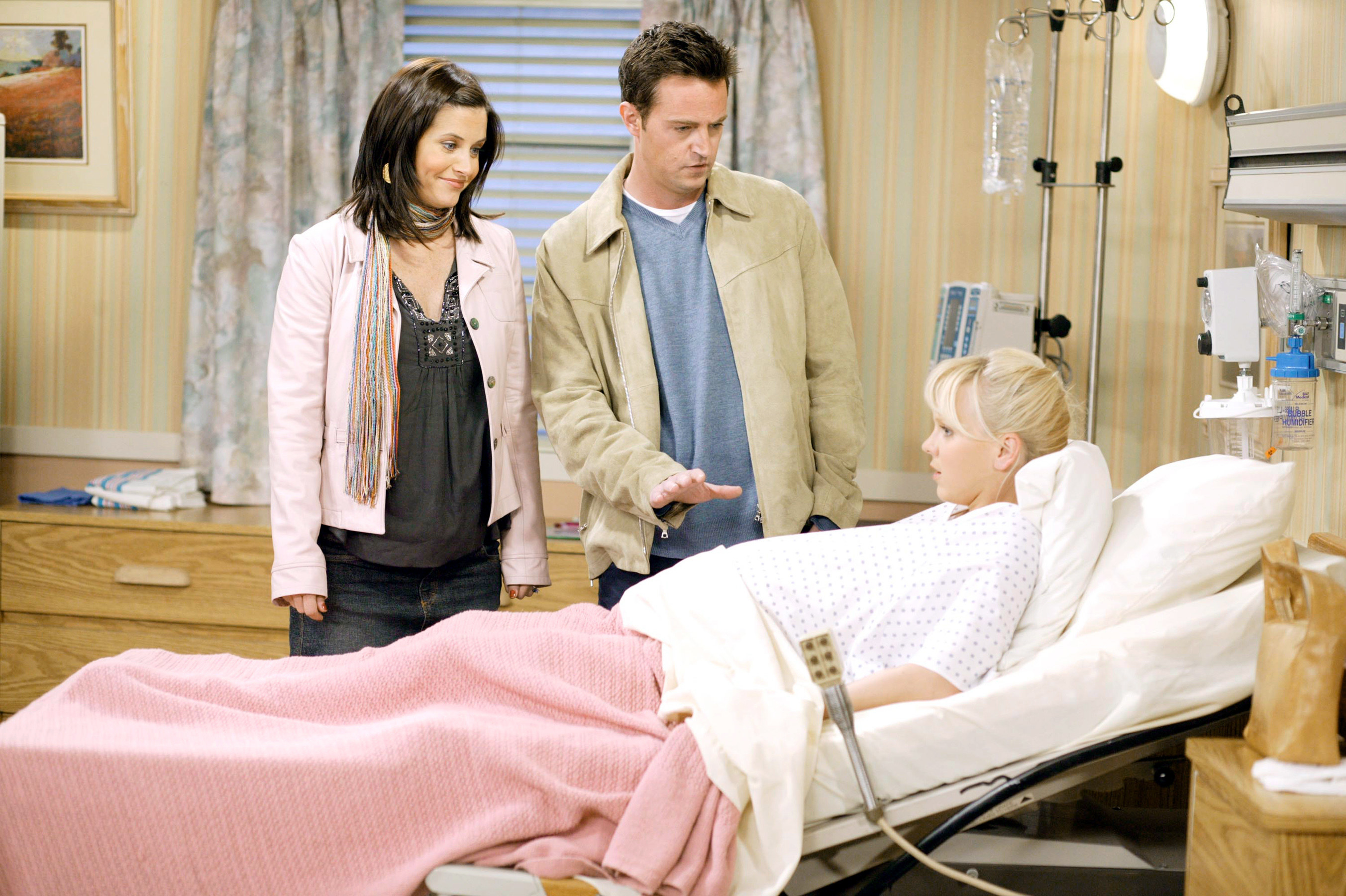 """Monica and Chandler visiting their surrogate, Erica in the hospital in """"Friends"""""""