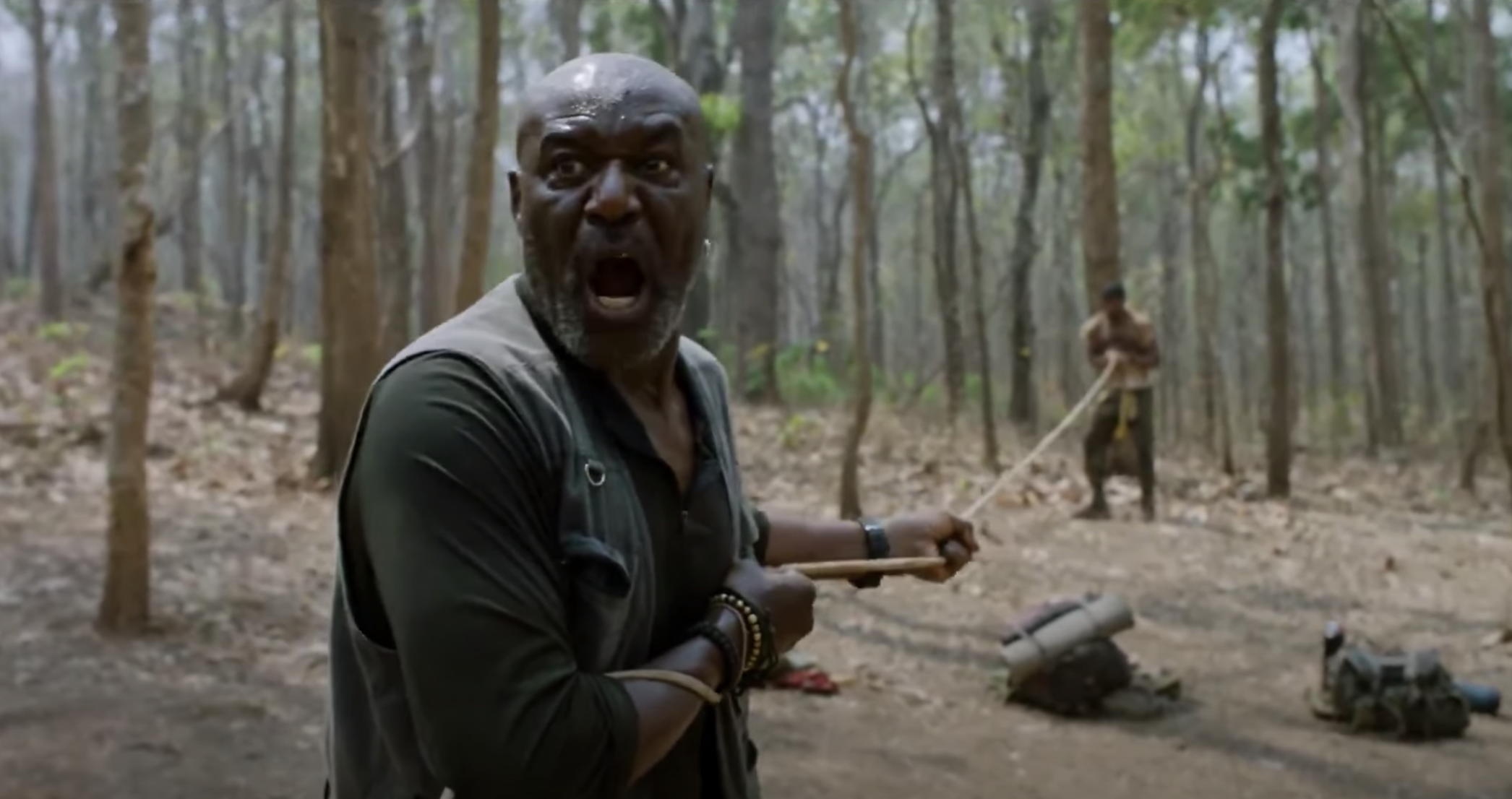 Lindo screams, afraid, as he prepares to pull his son off a landmine in Da 5 Bloods