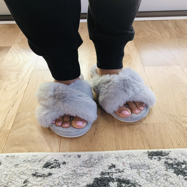 reviewer wearing slippers in grey