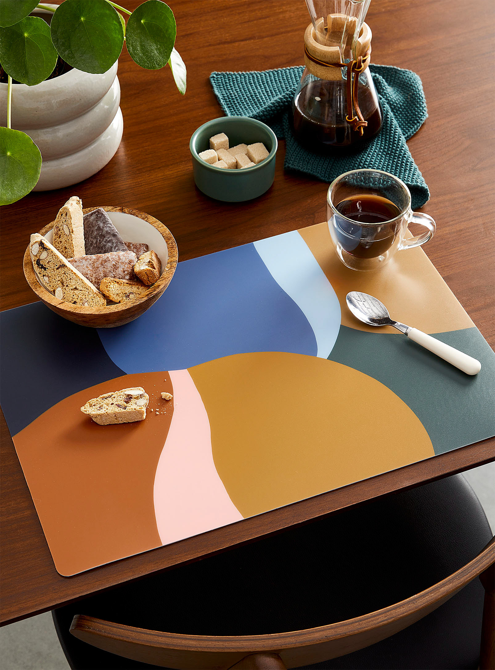 a colourful placemat on a table